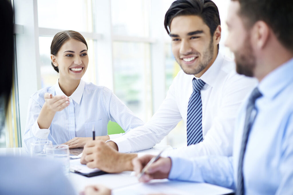 Business partners having a positive discussion, focus on beautiful young businesswoman